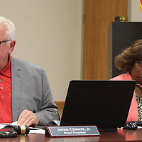 RAY VAN DUSEN/BUY AT PHOTOS.MONROECOUNTYJOURNAL.COM<br /> Aberdeen School Board President Jim Edwards conducts business with board member Sandra Peoples July 17 during the board's first meeting back in local control.