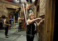 Cast and crew work together as they strike the Mousetrap set within a couple of hours of the final performance on Saturday evening to prepare for the upcoming Ballyhoo production beginning Wednesday.  (Karen Bobotas/for the Laconia Daily Sun)