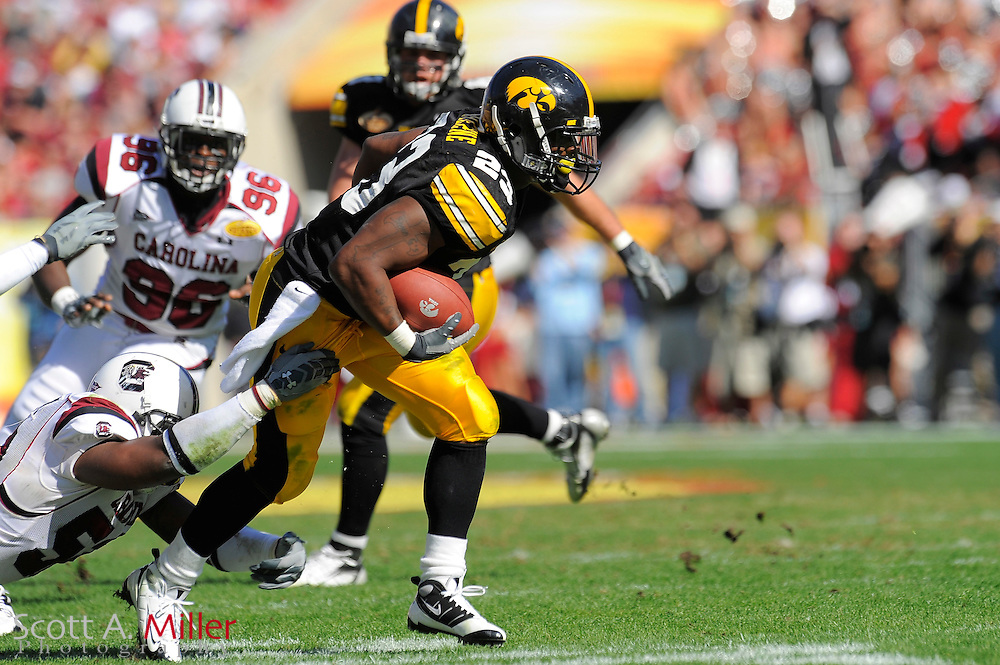 Jan 1, 2009; Tampa, FL, USA; Iowa Hawkeyes running back Shonn Greene (23) is tackled by South Carolina Gamecocks linebacker Marvin Sapp (53) during the first half of the Outback Bowl at the Raymond James Stadium ©2009 Scott A. Miller