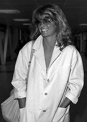 Sun-tanned American actress Farrah Fawcett-Majors at London's Heathrow Airport for brief visit before travelling on to the Cannes film festival.