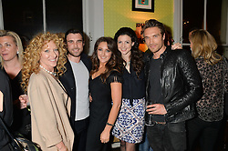 Left to right, KELLY HOPPEN, CHARLIE WATSON, NATASHA CORRETT, SHIRLEY LEIGH WOOD-OAKES and GILLES SOUTEYRAND at a party to celebrate the publication of 'Honestly Healthy For Life' by Natasha Corrett held at Bumpkin, 209 Westbourne Park Road, London on 26th March 2014.
