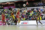 Uganda GD Lilian Ajio passes tp Uganda GK Stella Nanfuka during the Netball World Cup 2019 Preparation match between England Women and Uganda at Copper Box Arena, Queen Elizabeth Olympic Park, United Kingdom on 30 November 2018.