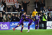 Elliot Embleton (22) of Grimsby Town and Mitch Rose (8) of Grimsby Town celebrate the 2-1 win over Exeter at full time during the EFL Sky Bet League 2 match between Exeter City and Grimsby Town FC at St James' Park, Exeter, England on 29 December 2018.