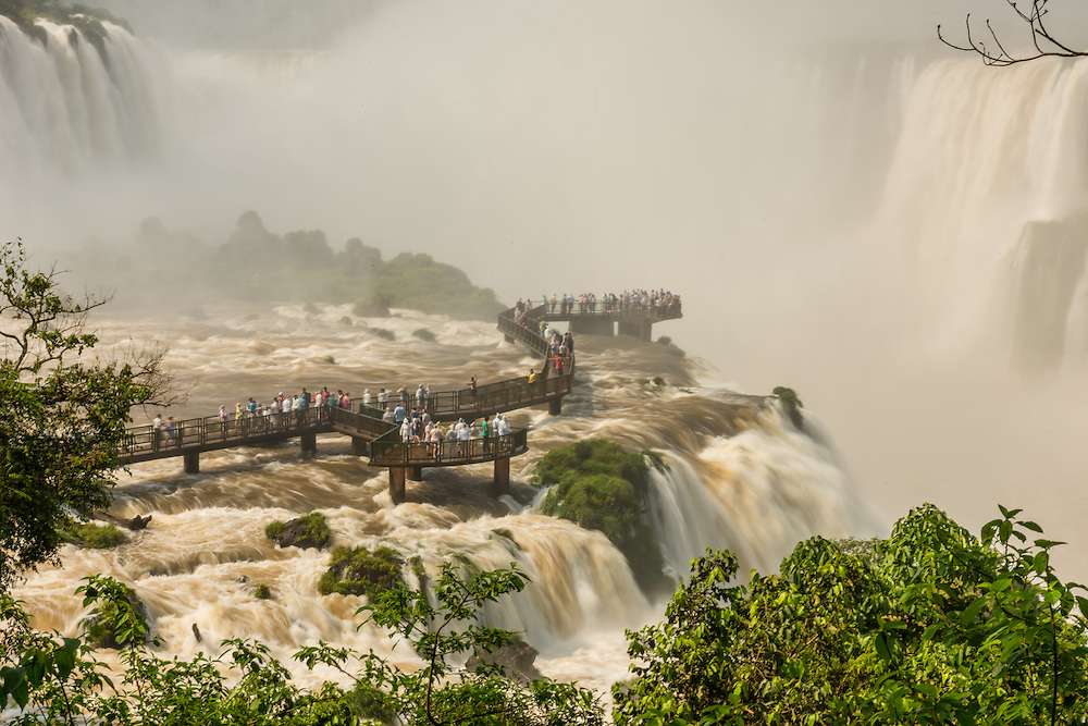Bridge with people in Garganta del Diablo, Iguazu Falls, Foz do Iguazu, Brazil.