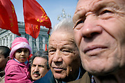 Communist supporters, carrying red flags, pour out on the street in Moscow on Labour Day to demonstrate.