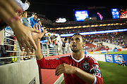 San Jose Earthquakes forward Chris Wondolowski (8) shakes hands with fans after beating the Seattle Sounders FC, 1-0, at Levi's Stadium in Santa Clara, California, on August 2, 2014. (Stan Olszewski/SOSKIphoto)