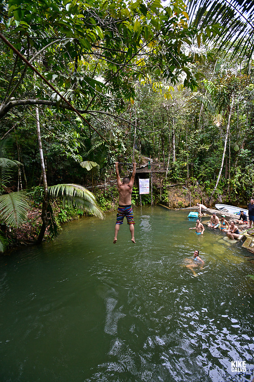 Tourist swim in a fresh water pool, National Natural Park of Uramba,  Bahia Malaga, Colombian Pacific Coast