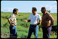Monsanto agronomst, Victor Carrao, talks to foreman & sharecrpper on rice farm Granja Bretanhas;RS Brazil