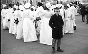 Neville beside church-goers. UK. 1980s.