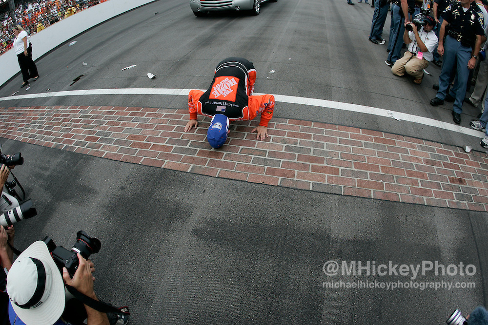 Tony Stewart kisses the bricks after winning the Allstate 400 at the Brickyard at the Indianapolis Motor Speedway Aug 7, 2005.