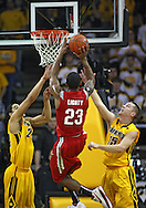 January 27, 2010: Ohio State guard/forward David Lighty (23) puts up a shot between Iowa forward Aaron Fuller (24) and Iowa guard Devan Bawinkel (15) during the second half of their game at Carver-Hawkeye Arena in Iowa City, Iowa on January 27, 2010. Ohio State defeated Iowa 65-57.