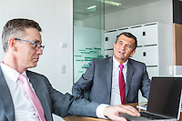 Mature businessmen discussing in office