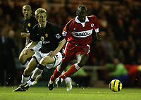 The FA Barclays Premiership<br />1 January 2005, The Riverside, Stadium, Middlesbrough<br />Middlesbrough v Manchester United<br />Manchester United's Darren Fletcher who scored his first goal for the club during the 2-0 win for the Old Trafford side is outpaced by Middlesbrough's Jimmy Floyd Hasselbaink<br />Pic Jason Cairnduff/Back Page Images