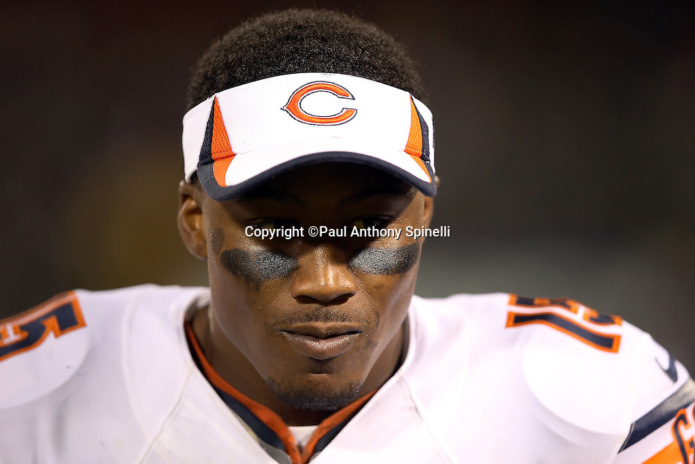 Chicago Bears wide receiver Brandon Marshall (15) looks on from the sideline during the NFL preseason week 3 football game against the Oakland Raiders on Friday, Aug. 23, 2013 in Oakland, Calif. The Bears won the game 34-26. ©Paul Anthony Spinelli