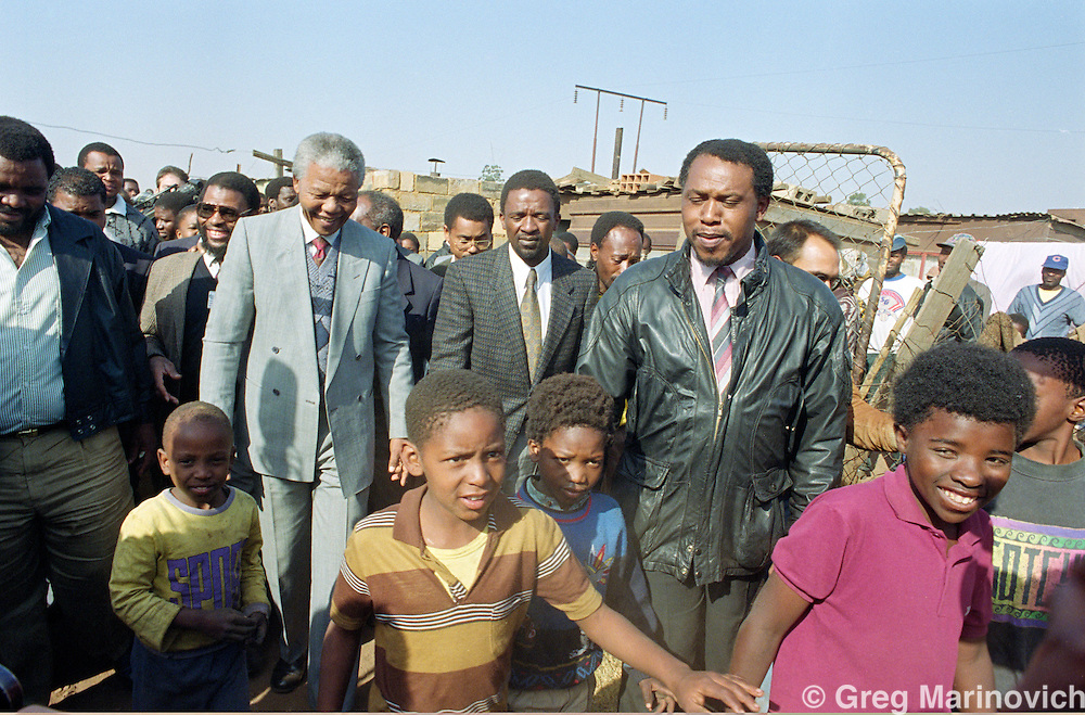 Phola Park, Thokoza, Transvaal, South Africa. Nelson Mandela at Phola Park, the site of much violence between ANC, IFP and police and SADF. 1990/1