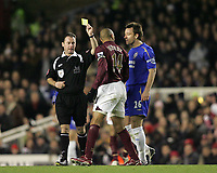 Photo: Lee Earle.<br /> Arsenal v Chelsea. The Barclays Premiership. 18/12/2005. Arsenal's Thierry Henry and John Terry have words as ref Styles shows Henry a yellow card.