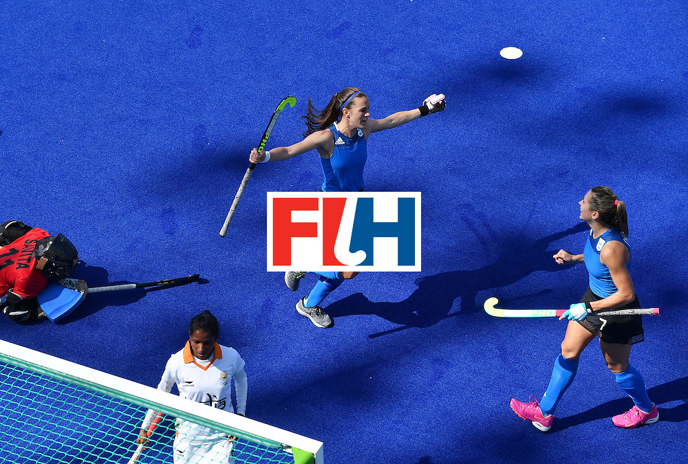 Argentina's Martina Cavallero (R) celebrates scoring with her team-mates during the women's field hockey Argentina vs India match of the Rio 2016 Olympics Games at the Olympic Hockey Centre in Rio de Janeiro on August, 13 2016. / AFP / MANAN VATSYAYANA        (Photo credit should read MANAN VATSYAYANA/AFP/Getty Images)