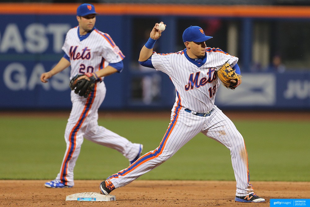 NEW YORK, NEW YORK - May 22:  Asdrubal Cabrera #13 of the New York Mets turns a double play watched by teammate Neil Walker #20 of the New York Mets during the Los Angeles Dodgers Vs New York Mets regular season MLB game at Citi Field on May 27, 2016 in New York City. (Photo by Tim Clayton/Corbis via Getty Images)