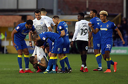 Tom Soares of AFC Wimbledon grabs Marcus Maddison of Peterborough United as tempers flare - Mandatory by-line: Joe Dent/JMP - 12/11/2017 - FOOTBALL - Cherry Red Records Stadium - Kingston upon Thames, England - AFC Wimbledon v Peterborough United - Sky Bet League One