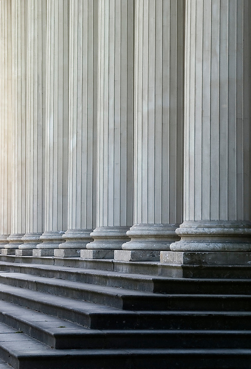 An abstract shot of the perfectly uniform columns and steps of Shugborough Hall.