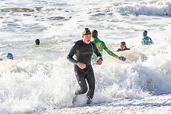 © Licensed to London News Pictures. 03/11/2016. Brighton, UK. Members of the Brighton Surf Life Saving Club take part in their weekly training session in the Brighton and Hove sea as powerful waves are hitting the shore. Photo credit: Hugo Michiels/LNP