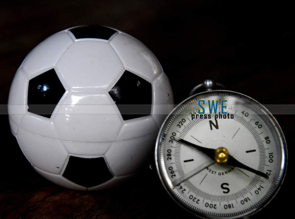 Rio de Janeiro-Brazil 19 May 2020, Soccer ball and compass, to show that Brazilian football has to take a turn, after this quarantine, due to the Coronavirus
