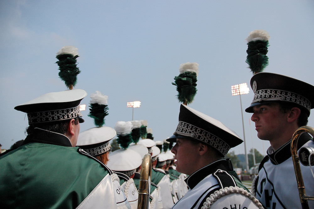 Krista McCormick and Scott Bucklad get ready to march on to the field, Saturday against Kent State