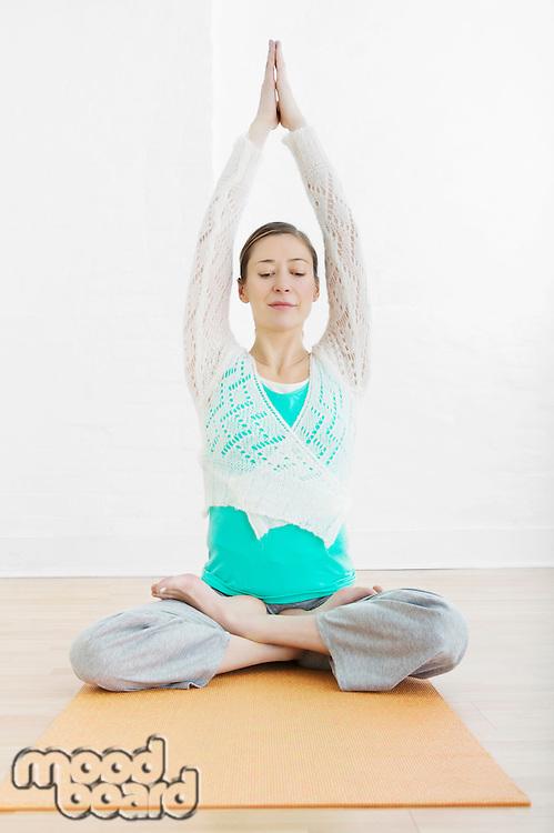 Teenage girl (16-17) performing yoga