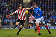 Sunderland Defender, Glenn Loovens (4) and Portsmouth Forward, Oliver Hawkins (9) challenge for the ball during the EFL Sky Bet League 1 match between Portsmouth and Sunderland at Fratton Park, Portsmouth, England on 22 December 2018.