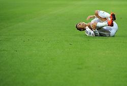 Real Madrid's Cristiano Ronaldo lies injured  - Photo mandatory by-line: Joe Meredith/JMP - Mobile: 07966 386802 12/08/2014 - SPORT - FOOTBALL - Cardiff - Cardiff City Stadium - Real Madrid v Sevilla - UEFA Super Cup