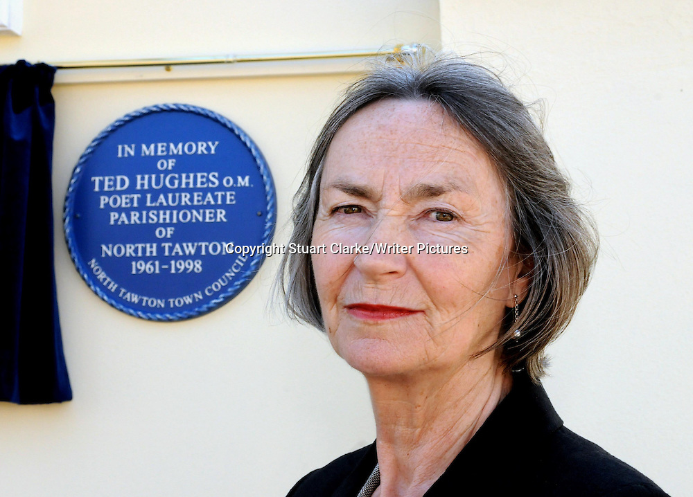 Carol Hughes the wife of the late Ted Hughes, poet Laureate, pictured with a comemorative blue plaque in the village of North Tawton, Devon<br /> <br /> Picture Copyright Stuart Clarke/Writer Pictures<br /> contact: +44 (0)20 822 41564<br /> sales@writerpictures.com<br /> www.writerpictures.com