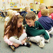 "ANNABELLE -- des moines, dec. 17 -- Annabelle Costanzo visited with her kindergarten classmate Max Guest while other students engaged in an activity.  Earlier that day during their morning prayers another classmate, Adam Chelleen, prayed that Annabelle would ""get unblind"".    .   The children ""love her so much,"" says Gina Costanzo, Annabelle's mother.  ""They're so good for her."" photo by david peterson"