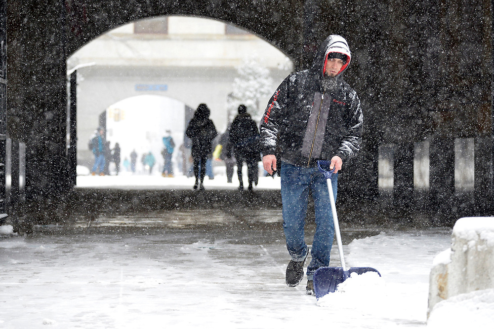 Philadelphia, PA, USA - February 20, 2019: Snow removal crews attempt to clear sidewalks at City Hall as Winter storm Petra brings several inches of snow to Philadelphia, PA, on February 20, 2019. The city is expected to receive five inches of snowfall before changing over to sleet.