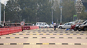 JINAN, CHINA - SEPTEMBER 22: (CHINA OUT) <br /> <br /> Intensive Deceleration Strips<br /> <br /> A citizen passes by intensive deceleration strips installed at north square of Jinan Sports Center on September 22, 2014 in Jinan, Shandong province of China. 10 deceleration strips with only 10 meter intervals between two latest strips are put on a road less than 200 meters at north square of Jinan Sports Center. The instalment of deceleration strips near fitness facilities is to prevent fasting vehicles from breaking citizens.<br /> ©Exclusivepix