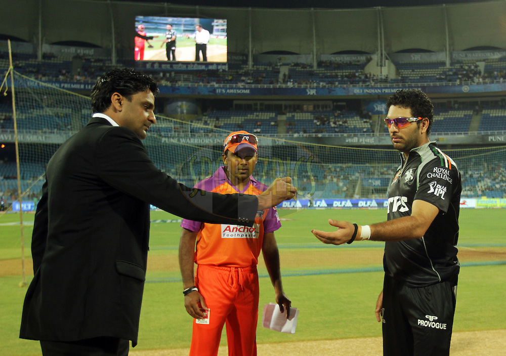 Javagl Srinath hands over the coin to Pune Warriors captain Yuvraj Singh as Mahela Jayawardene captain of Kochi Tuskers Kerala watches during  match 10 of the Indian Premier League ( IPL ) Season 4 between the Pune Warriors and the Kochi Tuskers Kerala held at the Dr DY Patil Sports Academy, Mumbai India on the 13th April 2011..Photo by BCCI/SPORTZPICS
