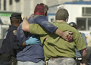 New York City Police officers are treated at a triage center at the New York Waterway ferry dock area on the  Jersey City waterfront after both the World Trade Towers collapsed on 09/11/01. Victims were transported by ferry across the Hudson.