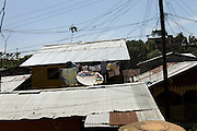 "The slum ""Union"" grows up on the border between Brasil and Colombia..The people who live there call the tri-border area between Colombia, Brazil and Perù ""La Frontera"".  This area, in the past rich field for seringueiros (rubber gatherer) and most recently narcos' territory, don't keep trace of the wealth generated here but spent elsewhere. Amazon frontiers areas are notorious for their sparse population and limited state presence."