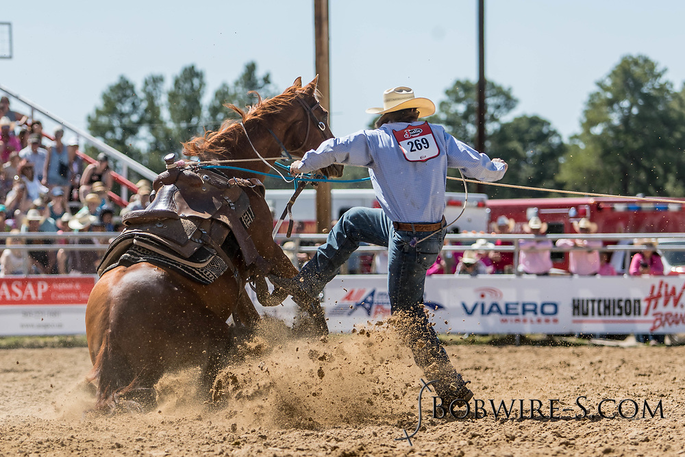 Tie-down roper Jack Tyner makes his run in the first performance of the Elizabeth Stampede on Saturday, June 2, 2018.