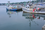 Scenic view of Digby, Nova Scotia Harbor on the Bay of Fundy with Scallop, Lobster,Halibut and Cod fishing boats common in the upper Atlantic coast. Scenic view of Digby, Nova Scotia Harbor on the Bay of Fundy with Scallop, Lobster,Halibut and Cod fishing boats common in the upperAtlantic coast.