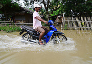 June 18, 2013 - Carmen, Davao Del Norte, Philippines -<br /> <br /> Flash Flood Aftermath In Southern Philippines<br /> Filipino resident wade on flood water as they pass by in Carmen, Southern Philippines, 18 June 2013. The Philippines' weather bureau is monitoring tropical depression 'Emong' (local name) was estimated based on all available data at 460 km East of Baler, Aurora (15.7¬∞N, 126.3¬∞E) with maximum sustained winds of 55 kph near the centre. It is forecast to move North Northwest at 15 kph.<br /> © Ritchie Tongo/Exclusivepix