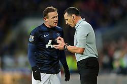 Man Utd Forward Wayne Rooney (ENG) argues with referee Neil Swarbrick after receiving a yellow card during the first half of the match - Photo mandatory by-line: Rogan Thomson/JMP - Tel: Mobile: 07966 386802 - 24/11/2013 - SPORT - FOOTBALL - Cardiff City Stadium - Cardiff City v Manchester United - Barclays Premier League.