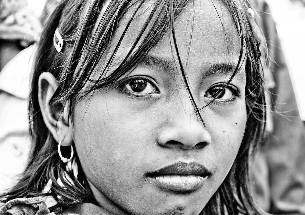 I went on a great trip to the island of Madura in Indonesia. In a local festival there I got one of my favourite portraits of a local girl on the beach. She seems so relaxed with the camera.