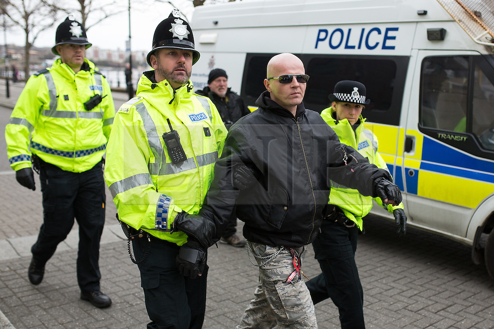 "© Licensed to London News Pictures . 21/03/2015 . Newcastle , UK . A Polish man at the  is arrested for Incitement to Racial Hatred following the burning of an Israeli flag . Neo-Nazis and skinheads from across Europe organise a "" White Man March "" in Newcastle , under the banner of "" National Action "" . Photo credit : Joel Goodman/LNP"