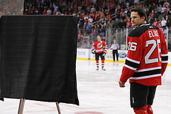 Jan 17; Newark, NJ, USA; New Jersey Devils center Patrik Elias (26) is honored for his 1000th game as a Devil before the first period at the Prudential Center.