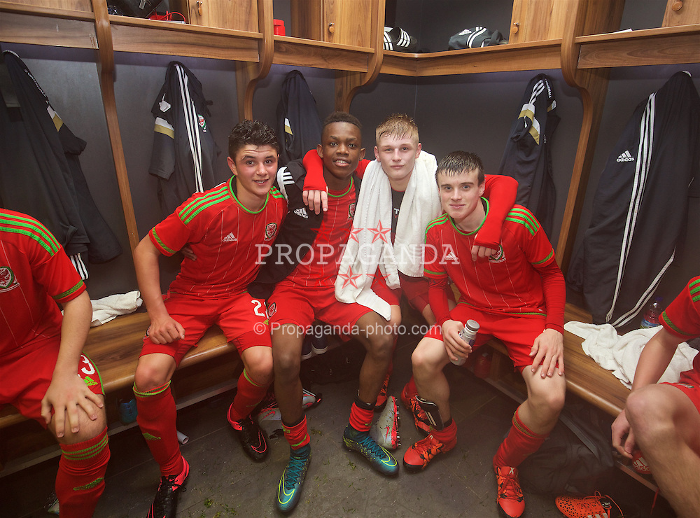 NEWPORT, WALES - Thursday, November 5, 2015: Wales' Steffan Buckeley, Rabbi Matonda, Ryan Stirk and Sion Spence celebrate in the dressing room after retaining the Victory Shield with a 3-1 win over Northern Ireland during the Under-16's Victory Shield International match at Dragon Park. (Pic by David Rawcliffe/Propaganda)