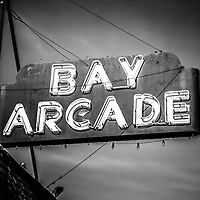 Bay Arcade Sign Newport Beach picture in black and white. The Bay Arcade is located in the Balboa Fun Zone on Balboa Peninsula in Orange County Southern California.