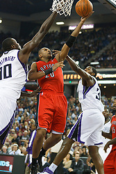 November 1, 2010; Sacramento, CA, USA;  Toronto Raptors shooting guard Leandro Barbosa (20) shoots past Sacramento Kings center Samuel Dalembert (10) and center Jason Thompson (34) during the fourth quarter at the ARCO Arena. The Kings defeated the Raptors 111-108.