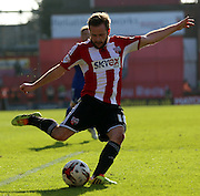 Alan Judge shooting during the Sky Bet Championship match between Brentford and Nottingham Forest at Griffin Park, London, England on 6 April 2015. Photo by Matthew Redman.