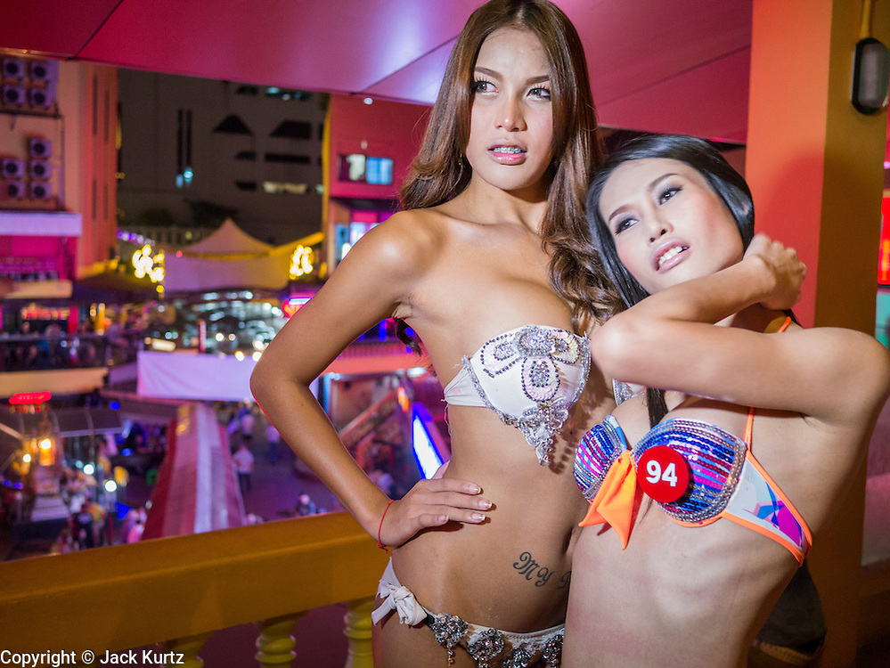 "05 JANUARY 2012 - BANGKOK, THAILAND: Sex workers solicit business and pose for photos in the Nana Entertainment District in Bangkok. Prostitution in Thailand is technically illegal, although in practice it is tolerated and partly regulated. Prostitution is practiced openly throughout the country. The number of prostitutes is difficult to determine, estimates vary widely. Since the Vietnam War, Thailand has gained international notoriety among travelers from many countries as a sex tourism destination. One estimate published in 2003 placed the trade at US$ 4.3 billion per year or about three percent of the Thai economy. It has been suggested that at least 10% of tourist dollars may be spent on the sex trade. According to a 2001 report by the World Health Organisation: ""There are between 150,000 and 200,000 sex workers (in Thailand).""      PHOTO BY JACK KURTZ"