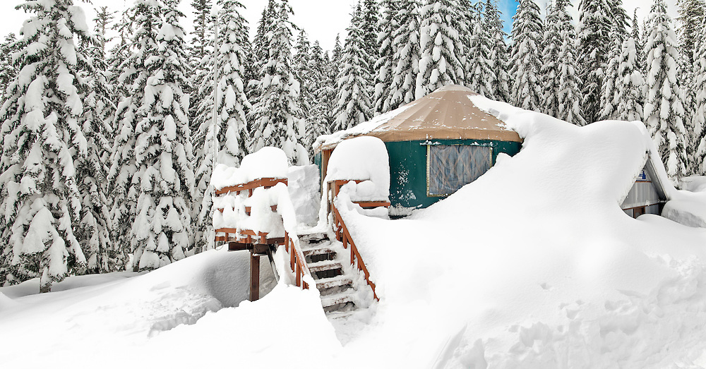 The Mount Tahoma Trails Yurt in deep snow of January  The Mount Tahoma Trails is a non-profit hut-to-hut crosscountry ski and snowshoe trail system in the Cascade Mountain Range of Washington state near Mount Rainier in the Tahoma State Forest, Ashford, WA and is maintained and supported by volunteers, donations, grants, and gifts.  The Yurt is located six miles over a couple high ridges from the trailhead and houses six guests and ski patrollers.  It is two stories high to better shed snow and has a stout framework to support a heavy snow load.